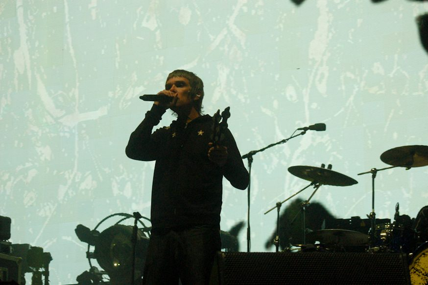 "Stone Roses Ian Brown Doubles Down on COVID-19 Conspiracy Theories, Says ""Plandemic"" was ""Designed and Executed To Make Us Digital Slaves"""