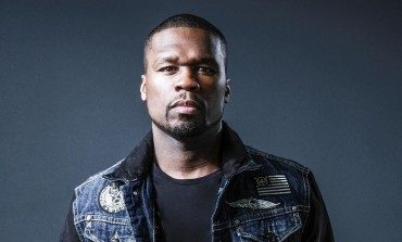 50 Cent Punches Woman Who Pulled Him Into the Crowd Before Inviting Her On Stage