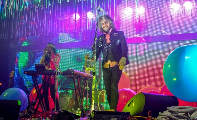 """The Flaming Lips Perform """"Will You Return / When You Come Down"""" Amid Sheets of Plastic in New Video"""