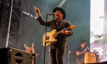 """Nathaniel Rateliff Strums His Guitar In Front Of A Mountain In New Music Video For """"Redemption,"""" Off The Soundtrack From The Upcoming Film Palmer Starring Justin Timberlake"""
