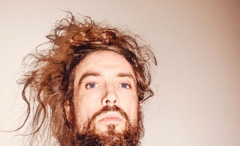 """Alex Ebert Releases Surreal Biology-Themed Video for Equally Bizarre New Song """"Fluid"""""""