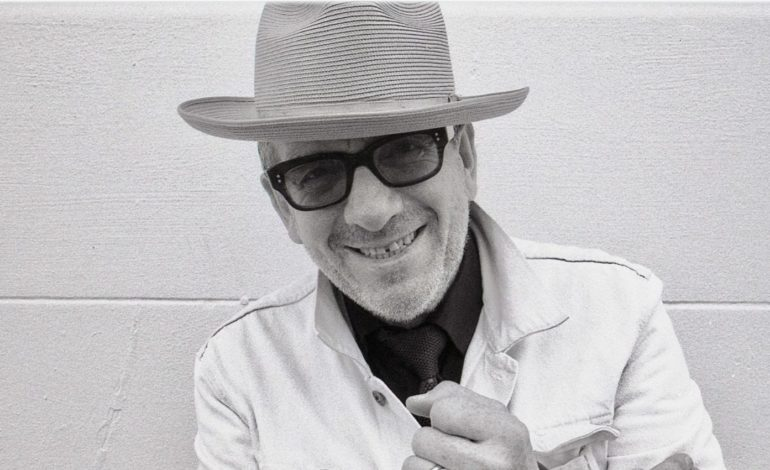 "Elvis Costello Shares Enchanting New Track ""Newspaper Pane"""